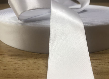 Smooth double sided woven edge polyester satin WD821