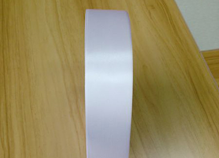 Economical single sided white polyester satin PS7022